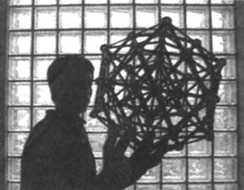 Kevin Chan, with a model of an icosahedron, actually two, one inside the other. He solved a computational problem involving atoms forming the structure.
